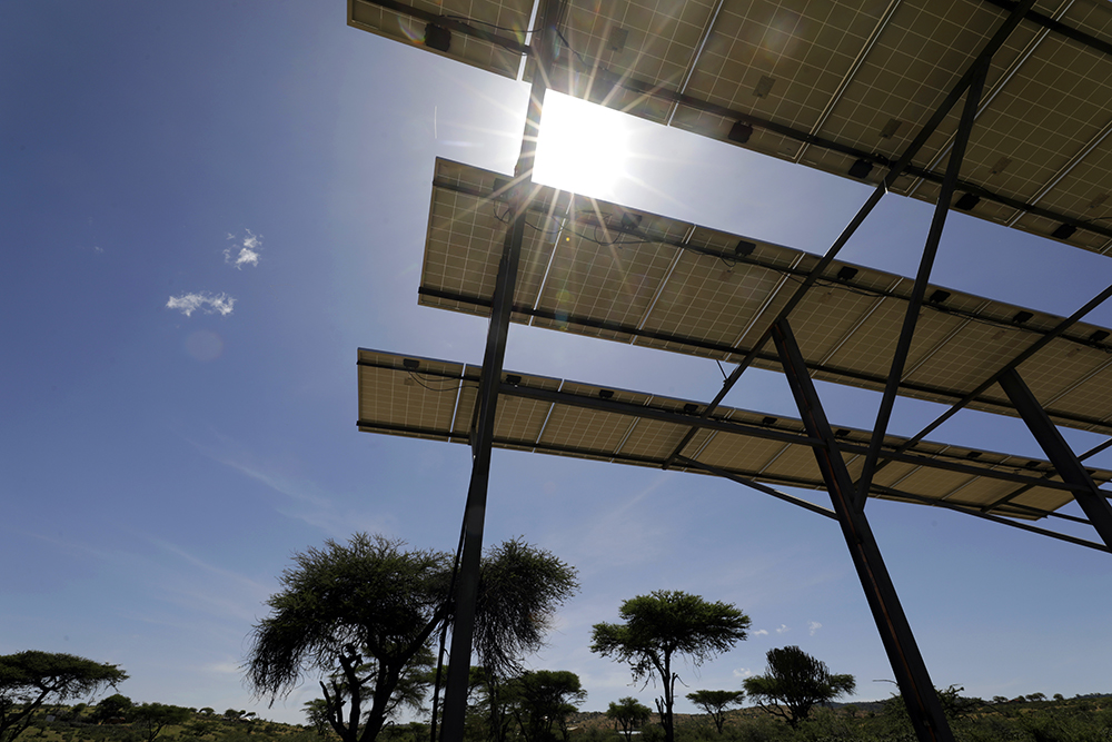 A solar panel drives the pump in a water sector project in Kenya.