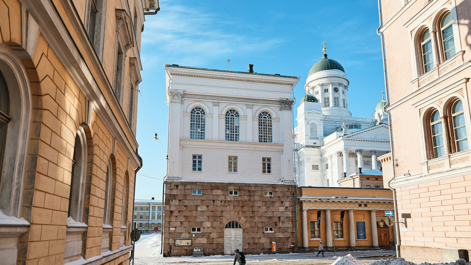 Neoclassical buildings, including the white Helsinki Cathedral.